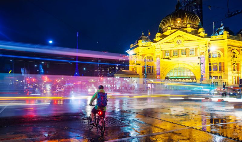 Traffic passing in front of Melbourne's Flinders Street Station at night