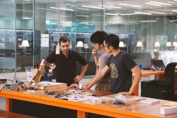 Photograph of students in the fabrication workshop.
