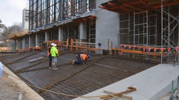The steel reinforcement being laid on top.