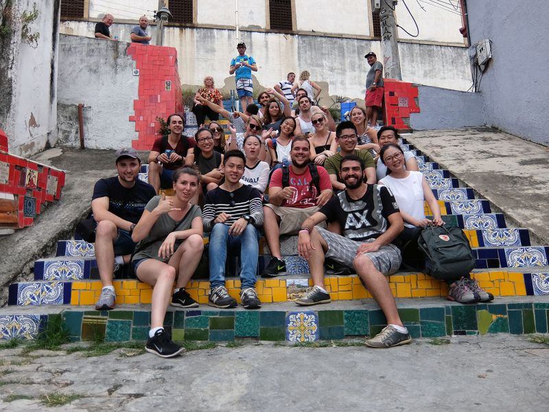 A group of students sitting on the steps at Escadaria Selarón, Rio de Janeiro