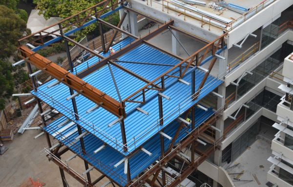 The blue material is Condek, a composite steel decking that supports the concrete as permanent formwork.